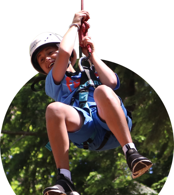 Boy smiling while hanging on a rope