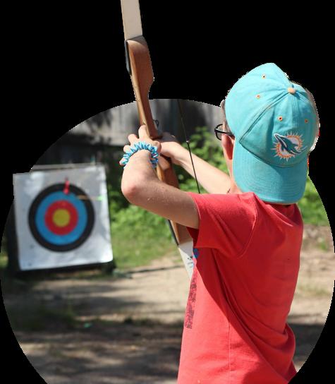 Child shooting an arrow at a target