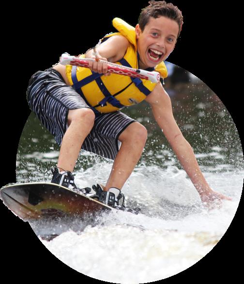 Excited boy waterskiing