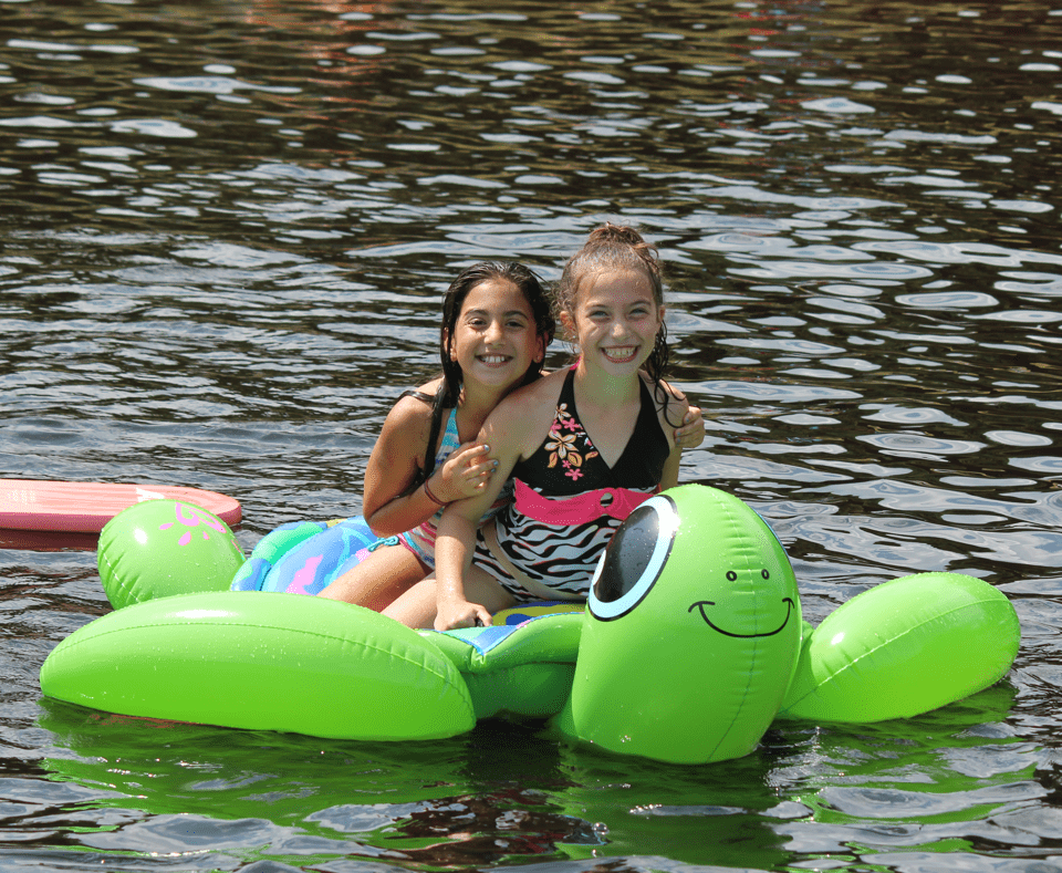 Campers on floaty in the lake
