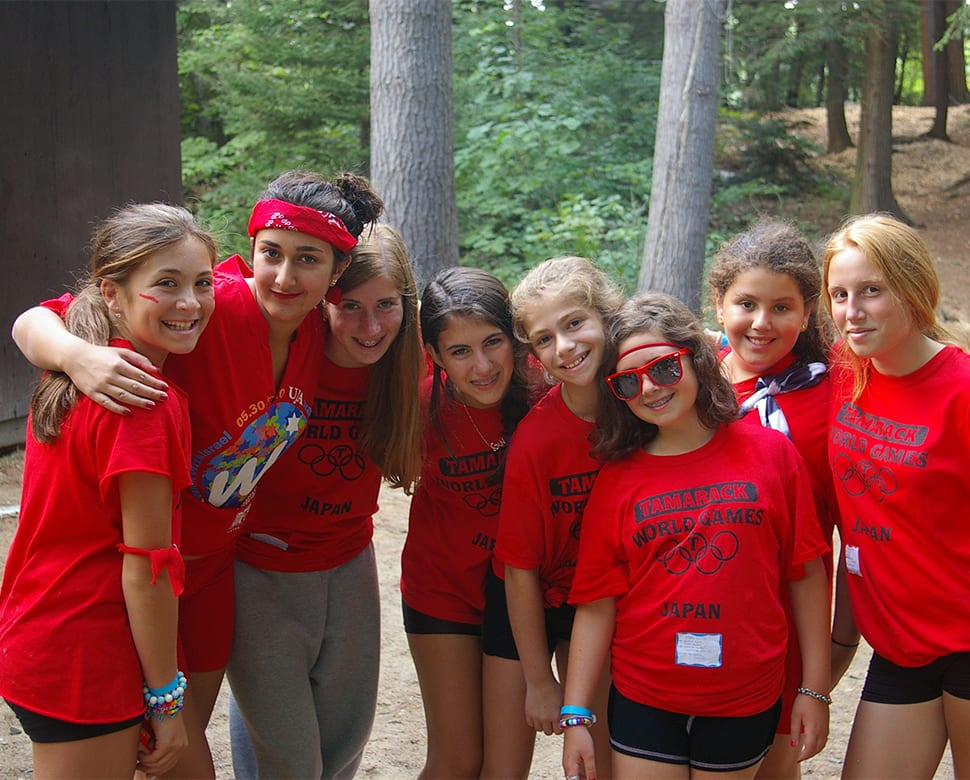 Group of young campers outside cabin at Camp Tamarack